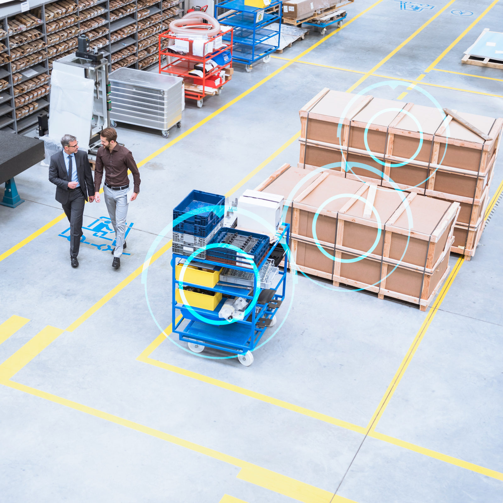 High angle view of supervisor and manager walking through distribution warehouse