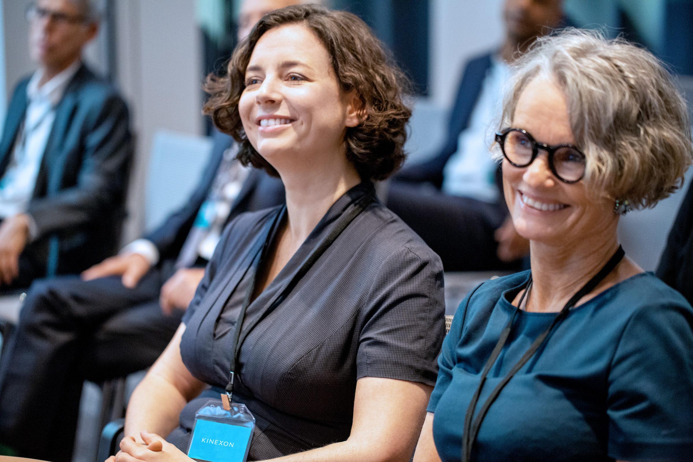 Smiling mature businesswoman attending seminar