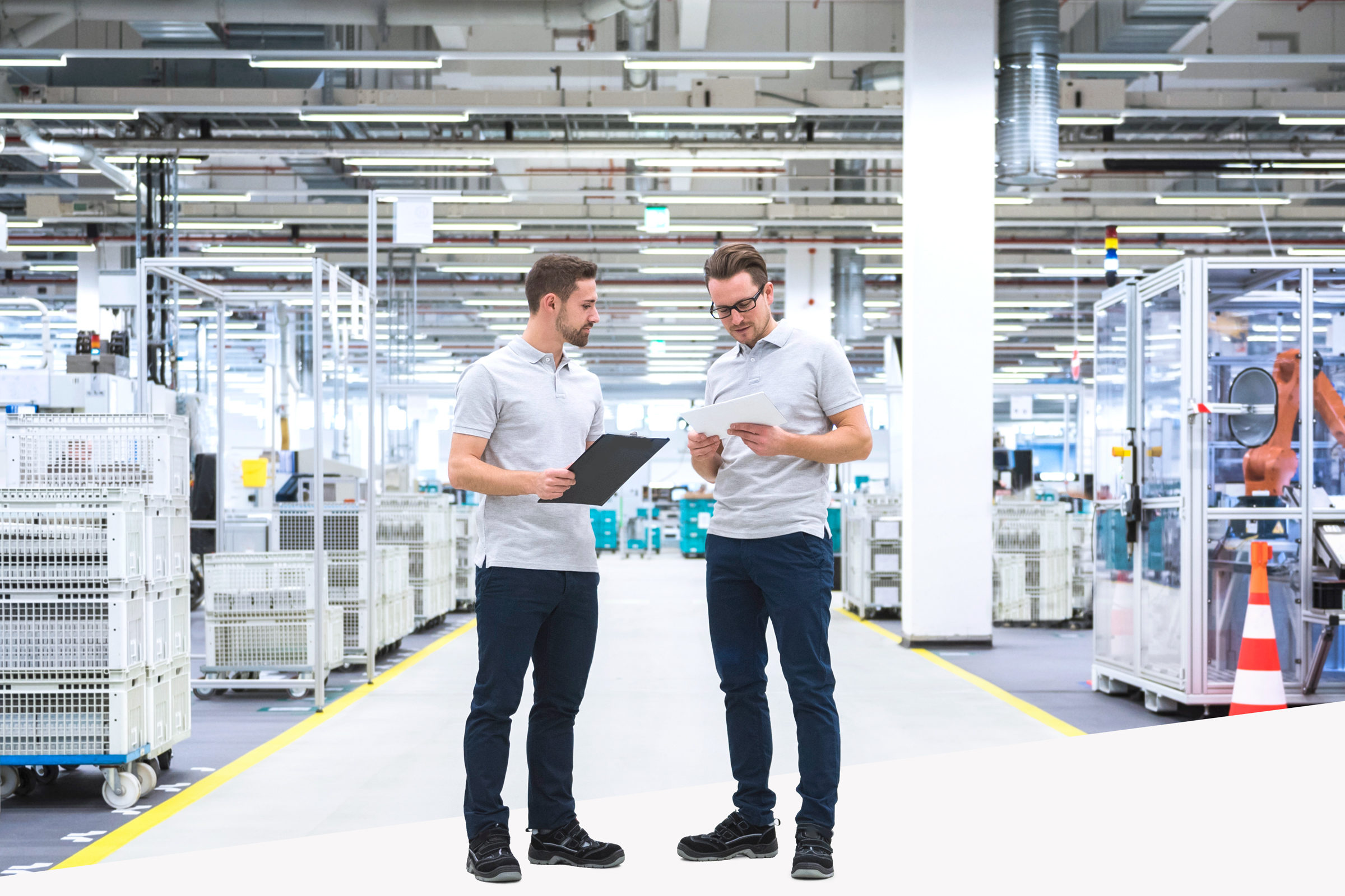 Two men talking in factory shop floor