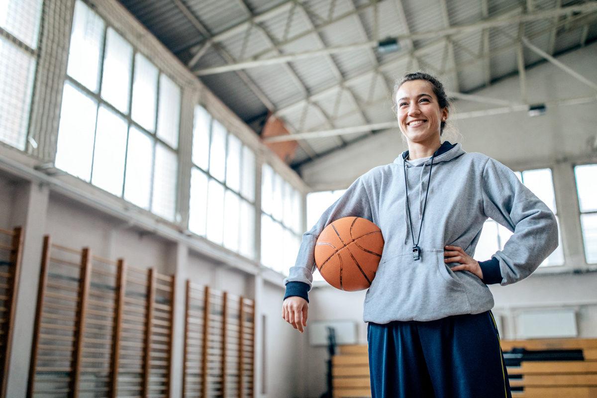 KINEXON Sports General Female Basketball Coach Partner Getty Images 1143302063 edited website
