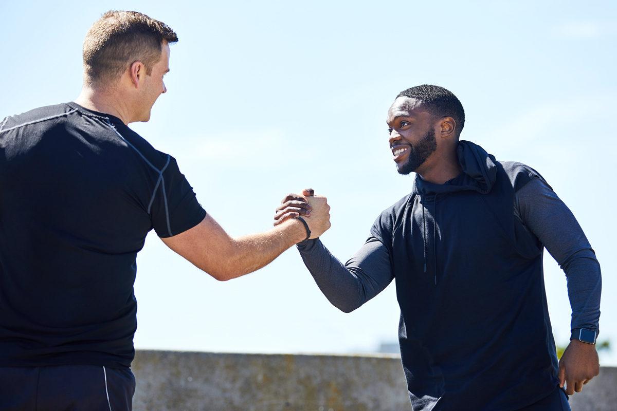 KINEXON Sports General Two Sportsmen Handshake Partner Getty Images 1201641504 edited website