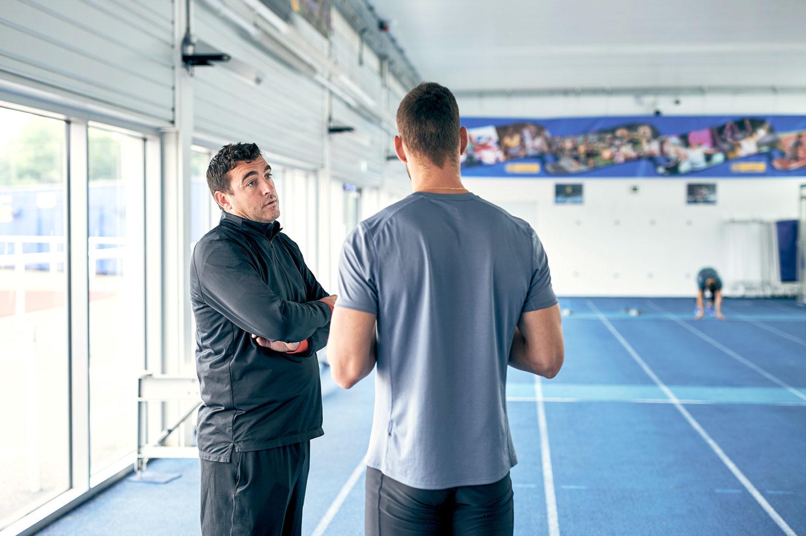 KINEXON Sports General Two Men Talking In Gym Getty Images 1129095502 edited website header