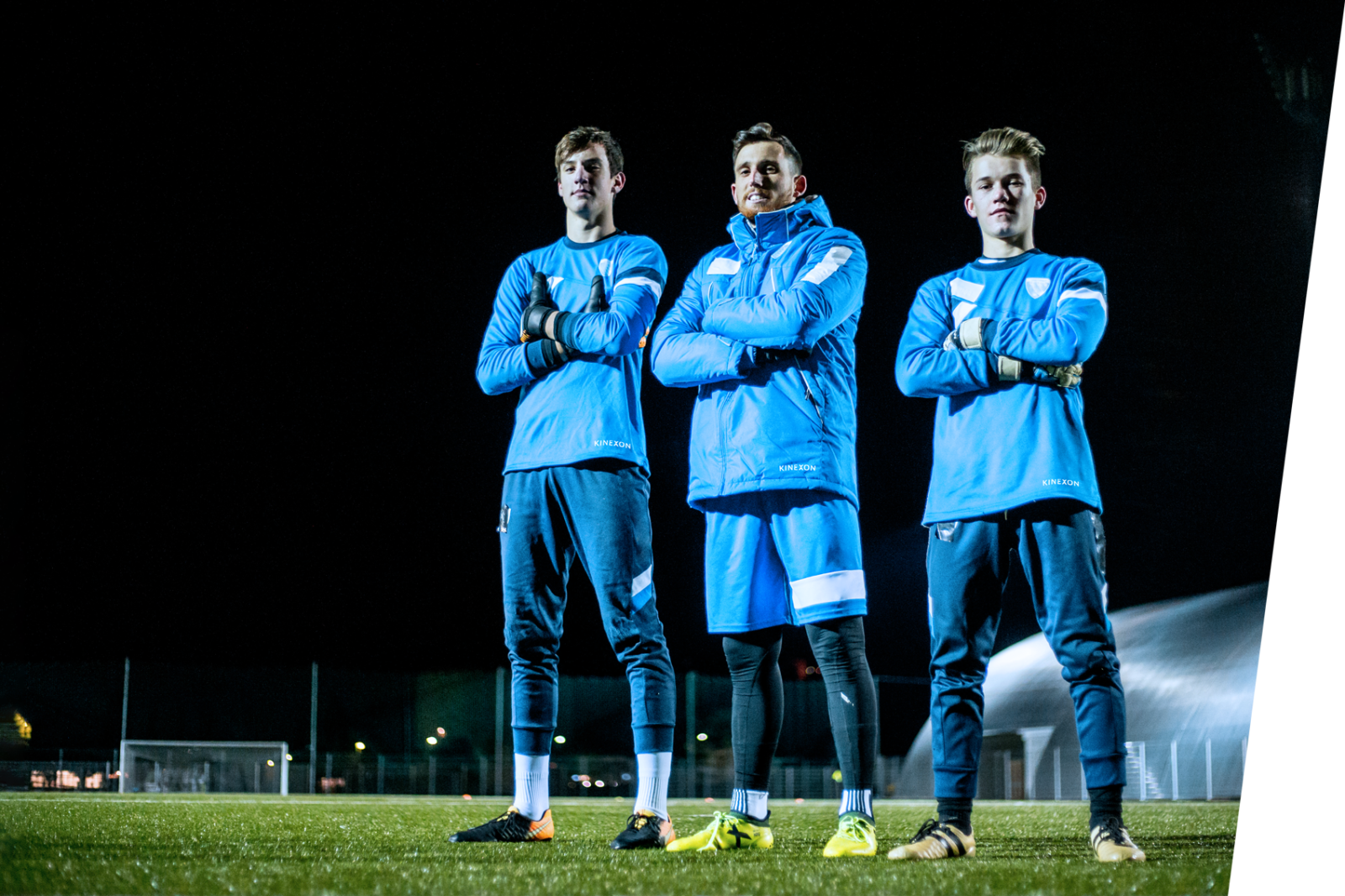 Goalkeepers and their coaches on football field