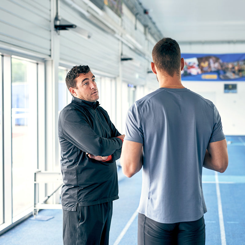 KINEXON Sports General Two Men Talking In Gym Getty Images 1129095502 edited