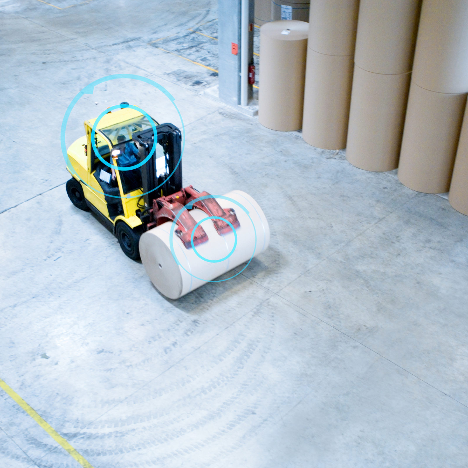 Forklift picking up roll of paper